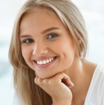 61732847-beautiful-woman-smiling-portrait-of-attractive-happy-healthy-girl-with-perfect-smile-white-teeth-blo